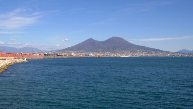 mount vesuvius (the volcano that destroyed pompeii in overlooks naples bay in  italy - italian culture stock videos & royalty-free footage