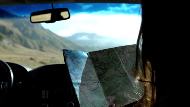 mountain adventure. woman travelling in a suv - car interior stock videos & royalty-free footage