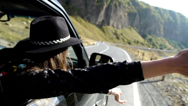 Mountain adventure. Woman travelling in a SUV
