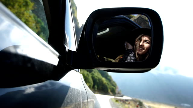 mountain adventure. woman travelling in a suv - rear view mirror stock videos and b-roll footage