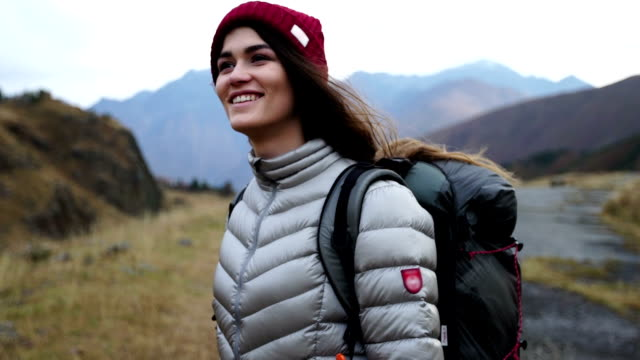 mountain adventure. young woman travelling - jacket stock videos & royalty-free footage