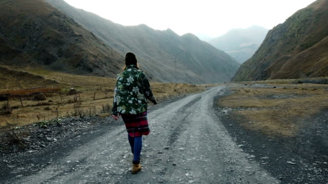 mountain adventure. young woman travelling - dirt track stock videos and b-roll footage