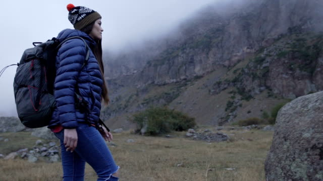 Mountain adventure. Young woman travelling