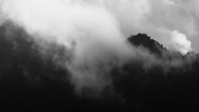 mountain and clouds - black and white stock videos & royalty-free footage