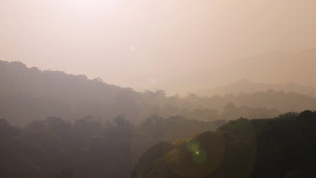 Mountain and rain forest with sunrise beam , 4k(UHD)