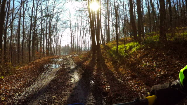 Mountain bike action from personal perspective.
