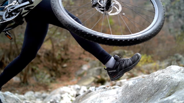 mountain biker ascends rock cliff - mountain biking stock videos & royalty-free footage