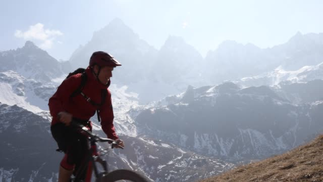 mountain biker ascends steep mountain slope - effort stock videos & royalty-free footage