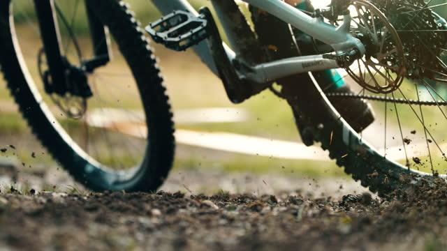 super slow motion mountain biker braking on the dirt - stunt stock videos & royalty-free footage
