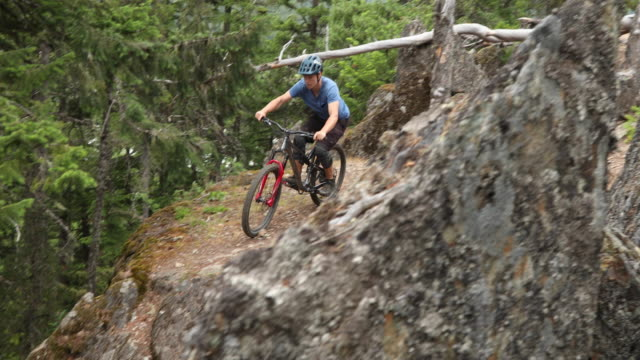 mountain biker descends steep and rocky trail - mountain biking stock videos & royalty-free footage