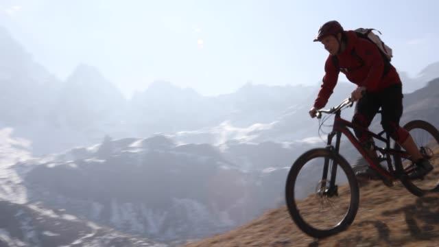 mountain biker descends steep mountain slope - mountain biking stock videos & royalty-free footage