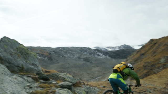 mountain biker descends steep rocky trail under matterhorn - mountain bike stock videos & royalty-free footage
