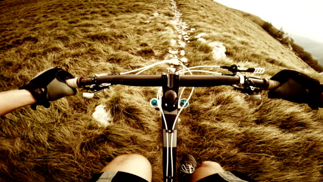 POV Mountain biker going up the ridge