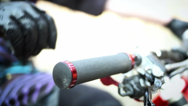 hd: mountain biker holding bicycle handlebar - handle stock videos and b-roll footage