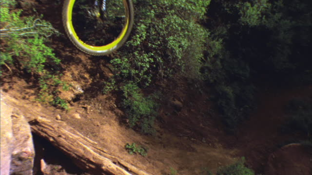 SM LA WS Mountain biker jumping off hill / Colorado, USA