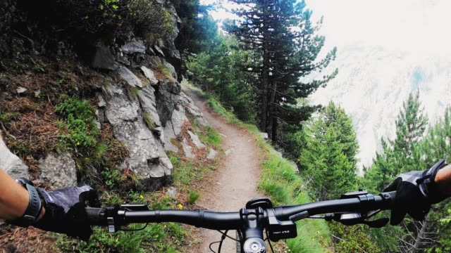 pov mountain biker on downhill trail in zermatt - extreme sports point of view stock videos & royalty-free footage
