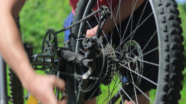 a mountain biker prepares to go biking. - repairing stock videos & royalty-free footage