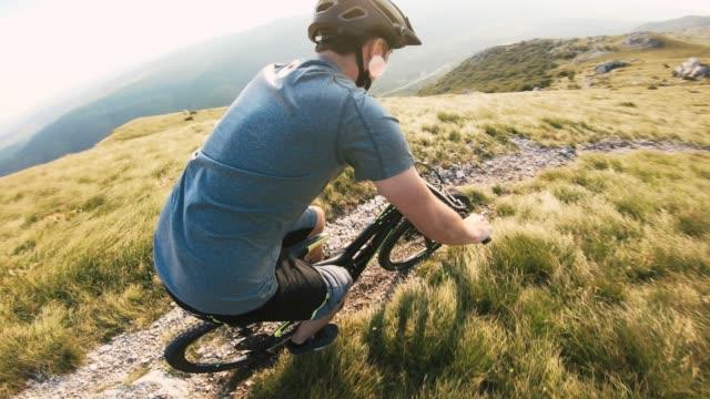 mountain biker racing down a mountain trail - recreational horseback riding stock videos & royalty-free footage
