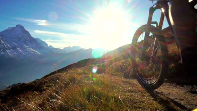 Mountain biker rides along high mountain trail