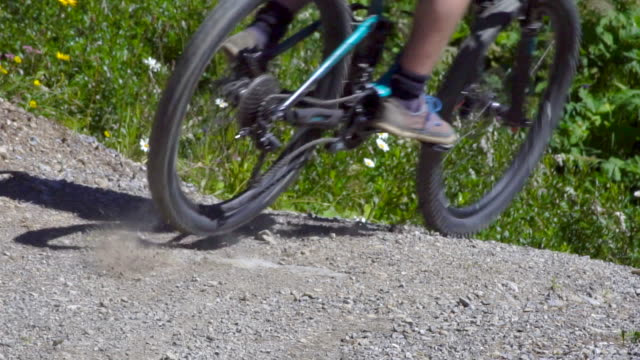 a mountain biker rides on a singletrack trail. - slow motion - human limb stock videos & royalty-free footage