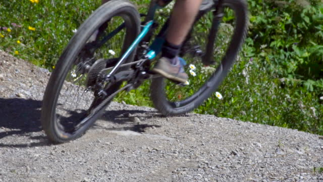 a mountain biker rides on a singletrack trail. - human limb stock videos & royalty-free footage