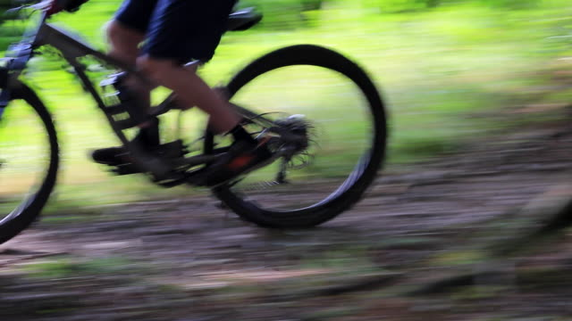 a mountain biker rides on a singletrack trail. - goodsportvideo stock videos and b-roll footage