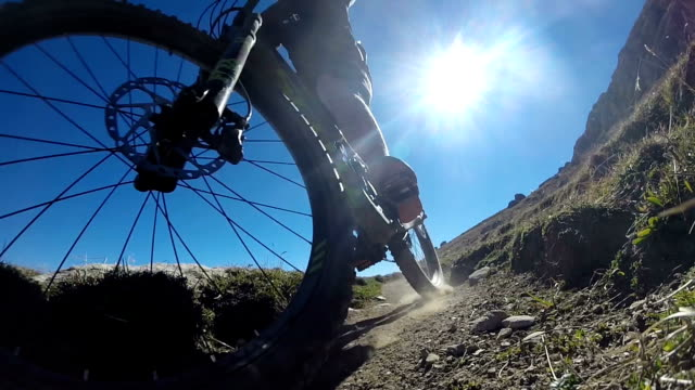 mountain biker rides through swiss alps near st. moriz - mountain bike stock videos & royalty-free footage