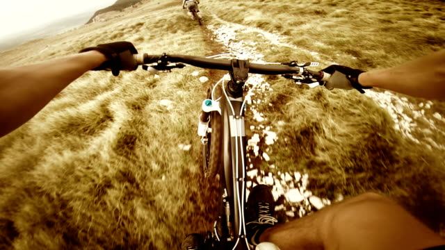 POV Mountain biker riding down the ridge