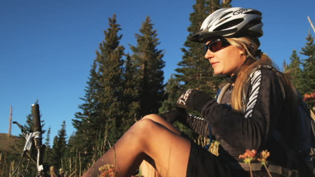 mountain biker sitting down to rest - brighton ski area stock videos and b-roll footage