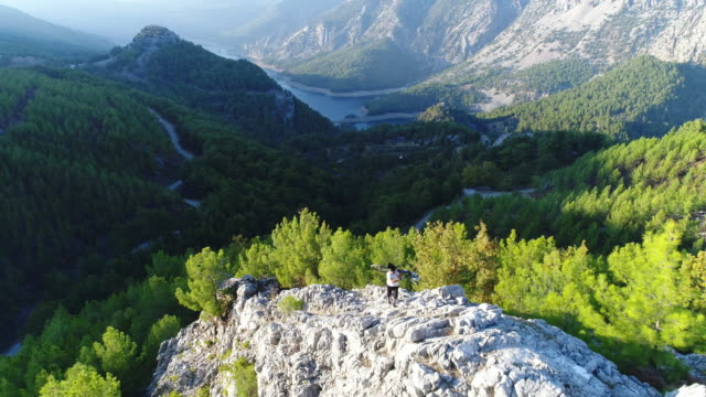 mountain biker standing on a rocky hillside - turkey stock videos and b-roll footage