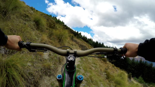 POV of mountain biker traversing mountain trail