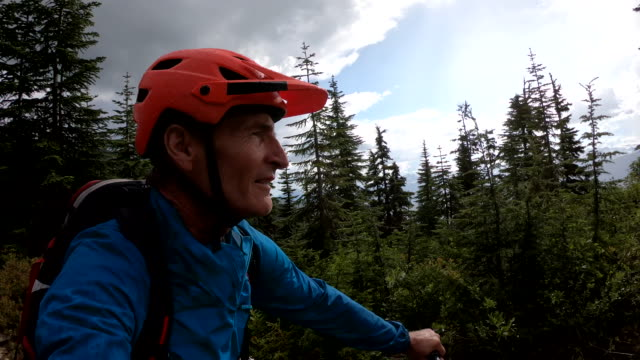 pov of mountain biker traversing trail above valley - one mature man only stock videos & royalty-free footage