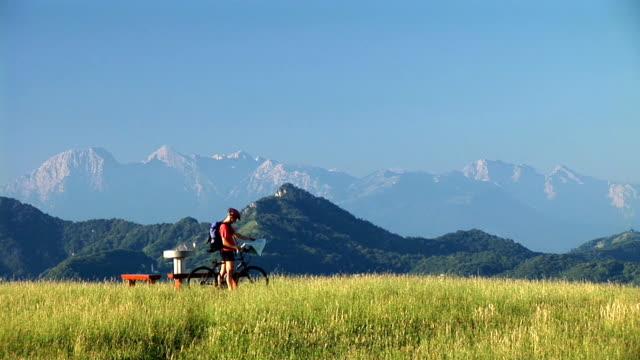 hd: mountain biker - road map stock videos & royalty-free footage