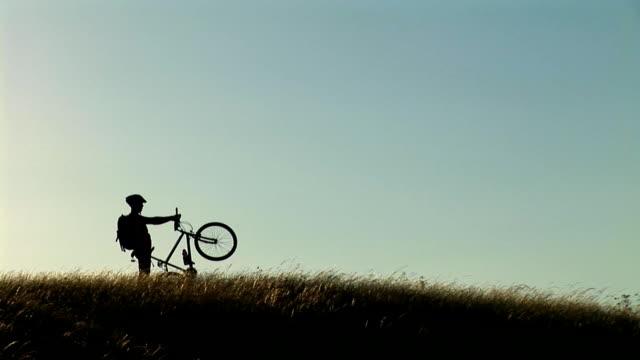 hd: mountain biker - rolling landscape stock videos & royalty-free footage
