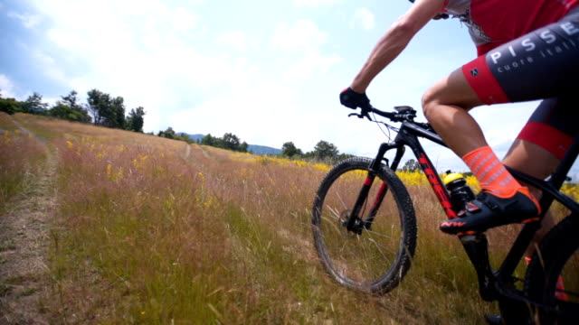 mountain bikers ascending to the top - mountain bike stock videos & royalty-free footage
