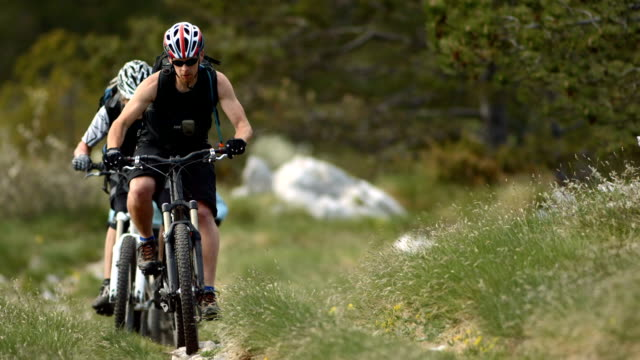 HD SLOW MOTION: Mountain Bikers Going Uphill