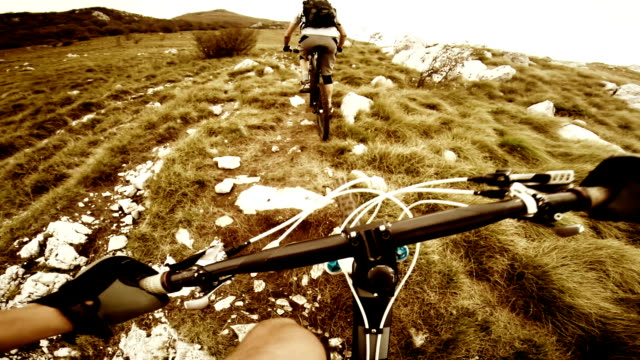 POV Mountain bikers going uphill