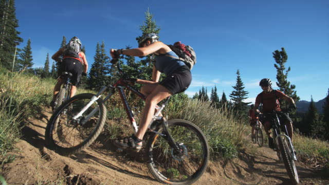 mountain bikers making a turn - spandex stock videos & royalty-free footage