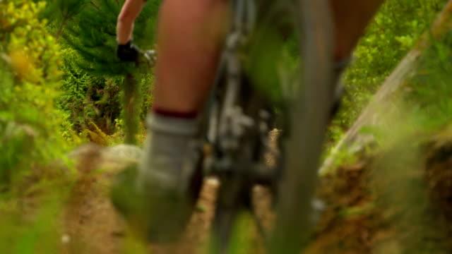 mountain bikers narrow dof slow motion - mountain bike stock videos & royalty-free footage