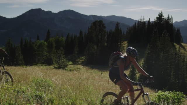 mountain bikers on a trail - spandex stock videos & royalty-free footage