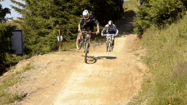 mountain bikers on single track trail  - 1920x1080 - helm stock-videos und b-roll-filmmaterial