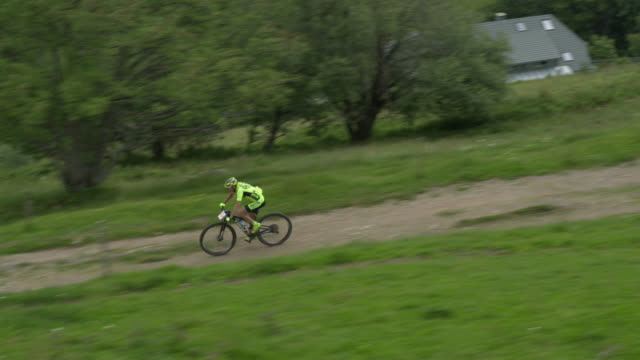 Mountain bikers race through rural German farmland
