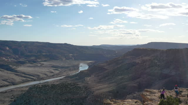 mountain bikers ride to edge of canyon overlook - colorado stock videos & royalty-free footage