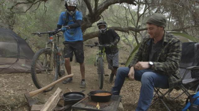 mountain biking bmx camping riding hard mud spalsh water air - young men stock videos & royalty-free footage