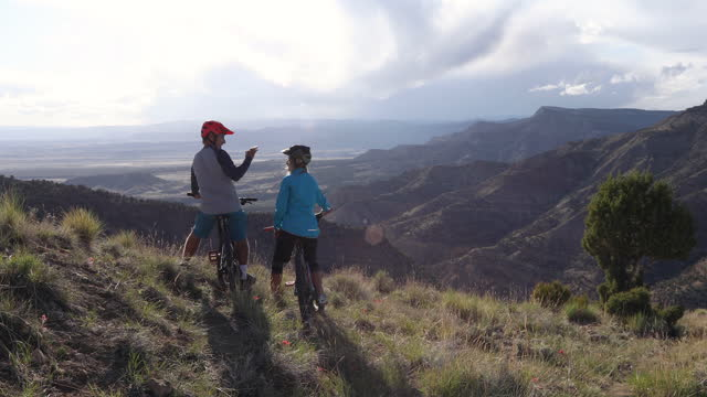 mountain biking father and daughter pause on trail to exchange  high-fives - exchanging stock videos & royalty-free footage