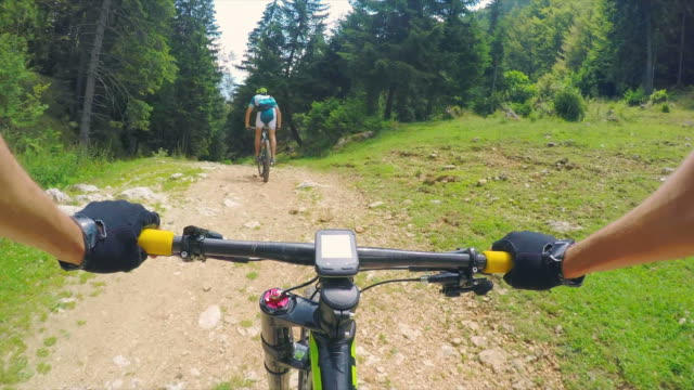 pov mountain biking is great! - mountain biking stock videos & royalty-free footage