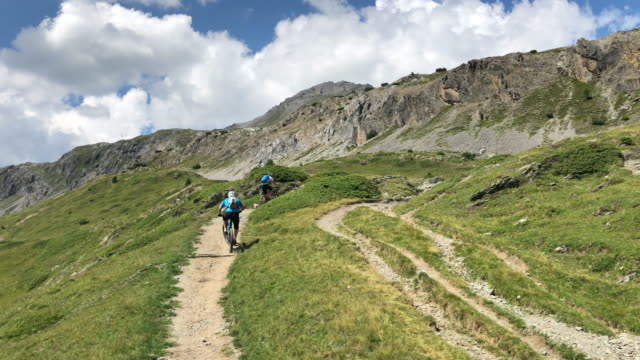 Mountain biking on a singletrack trail. - Slow Motion