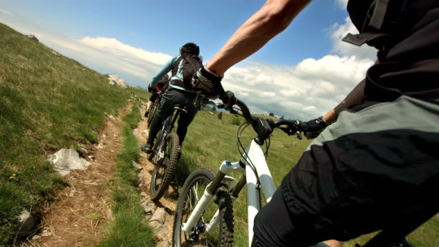hd slow motion: mountain biking on the countryside trail - bicycle trail outdoor sports stock videos & royalty-free footage