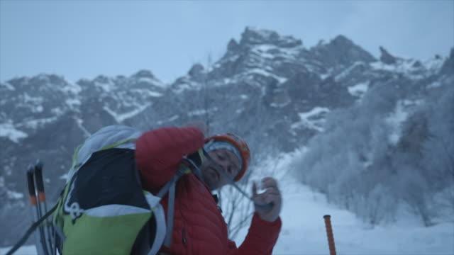 A mountain climber climbing in the snow.