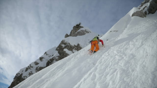 a mountain climber climbing up with crampons in the snow. - mont blanc stock videos & royalty-free footage